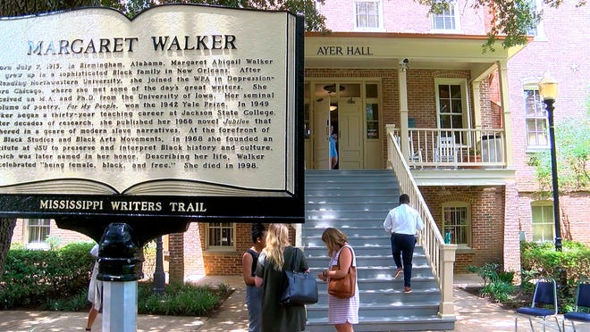 """In this image take from video on Monday, July 8, 2019, the new Mississippi Writers Trail marker honoring novelist and poet Margaret Walker Alexander, stands in the foreground of Ayers Hall on the Jackson State University campus, after being unveiled in Jackson, Miss. Walker was an English professor from 1949 to 1979. In 1942, she became the first African American woman to win the Yale Prize for her poetry collection, """"For My People."""" One of her best known novels, """"Jubilee,"""" was published in 1966 and tells of a biracial woman born into slavery in the American South."""