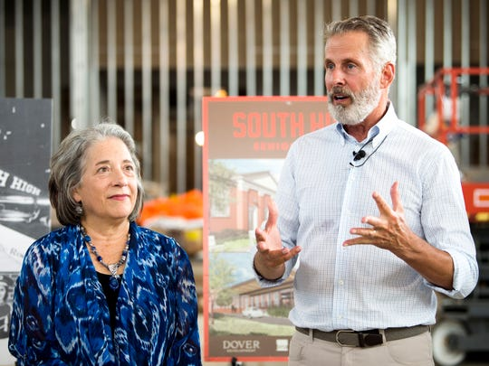 With Mayor Madeline Rogero looking on, developer Rick Dover speaks at an event at South High in Knoxville on Tuesday, July 9, 2019. South High is being redeveloped into a senior living center.