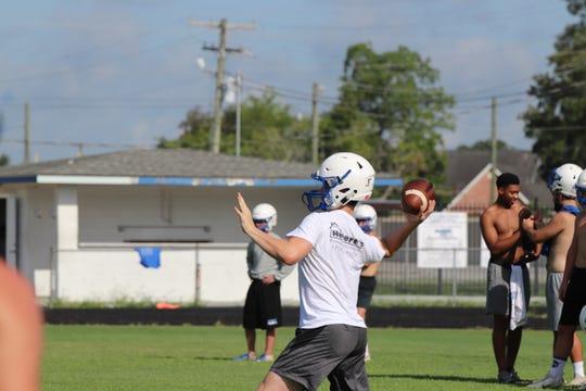 Erath quarterback Luke LeBlanc throws a pass during practice.