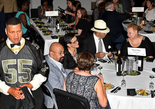 St. Landry Parish Councilman Dexter Brown keeps a keen eye on his table as he serves as a celebrity waiter at the 2018 Men Who Wait on Women Who Wine event.