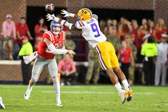 Oct 21, 2017; Oxford, MS, USA; LSU Tigers safety Grant Delpit (9) defends a pass by Mississippi Rebels quarterback Shea Patterson (20) during the first quarter at Vaught-Hemingway Stadium. Mandatory Credit: Matt Bush-USA TODAY Sports
