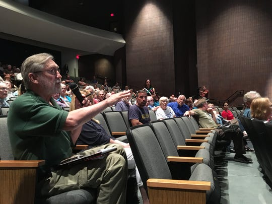 Bob Potacki, a Brighton resident who lives near Woodland Lake, asked a panel including U.S. Rep. Elissa Slotkin, about PFAS testing and costs for it during a forum Monday July 8, 2019 at the Jane Tasch Performing Arts Center in Pinckney. The forum was attended by nearly 200 people.