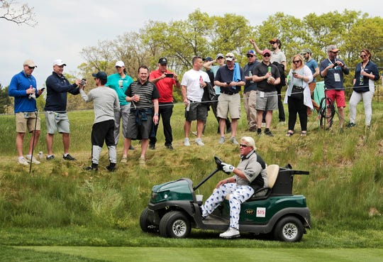 FILE - In this May 17, 2019 file photo, John Daly drives his cart off the 16th tee during the second round of the PGA Championship golf tournament, at Bethpage Black in Farmingdale, N.Y. Organizers of the British Open have refused a request by former champion John Daly to use a golf cart at the championship in Royal Portrush this month. Daly had applied to use a cart because of his arthritic right knee.