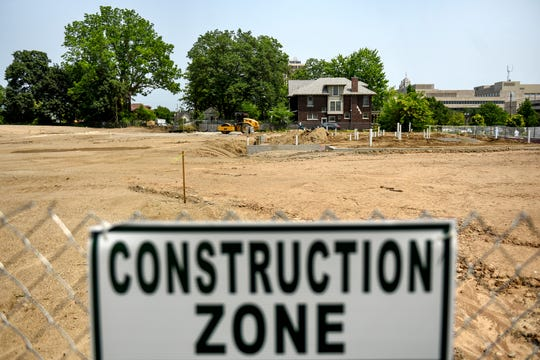The construction site of a future apartment complex on Ottawa Street west of the Capitol Tuesday, July, 9, 2019, in Lansing.