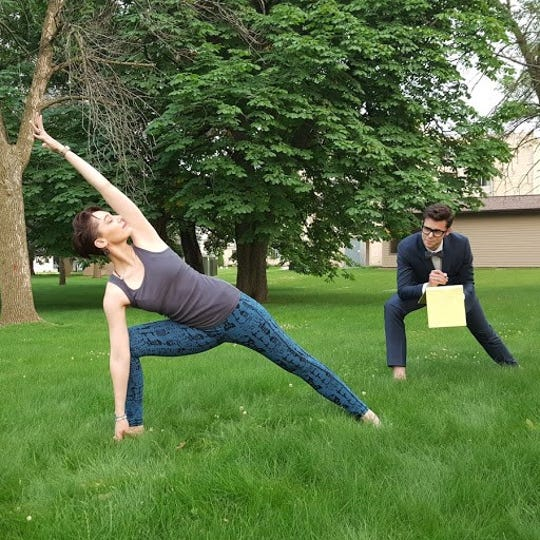 Manitowoc Public Library's J. Thomas Kelly interviews yoga instructor Kate Casey.