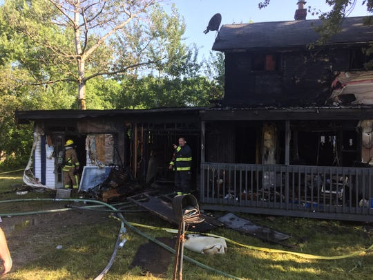 Firefighters were back on the scene of a house fire on Tuesday morning. The fire destroyed the house at 1004 Hanna Road in Madison Township.