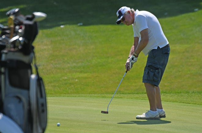 John Saterfield of Mansfield putts on the ninth hole at the Woods at Possum Run Golf Course.