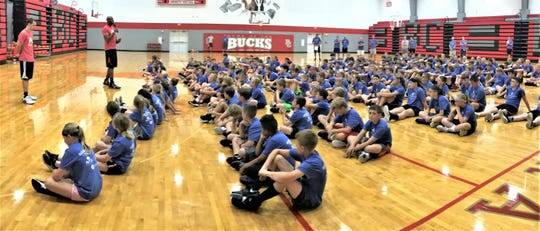 Former Ohio State Buckeye basketball players Aaron Craft (left) and Dallas Lauderdale speak with more that 200 Next Level Basketball 419 Campers on Tuesday morning at Buckeye Central High School.