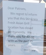 A sign announces the closing of Stir Crazy Fresh Asian Grill, 15795 Bluemound Road, on July 8.