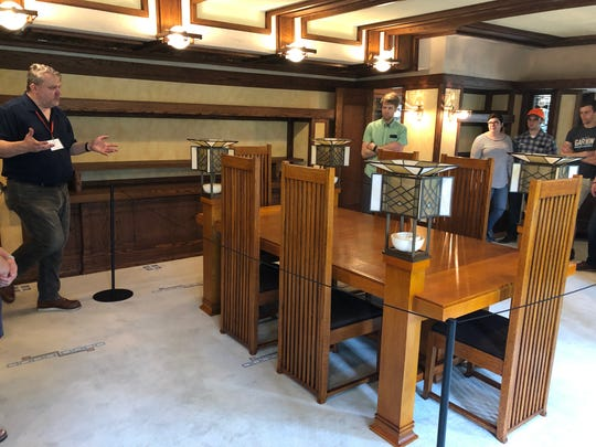 The Frank Lloyd Wright-designed Robie House in Chicago includes some furniture designed by Wright, like this dining room table and chairs.
