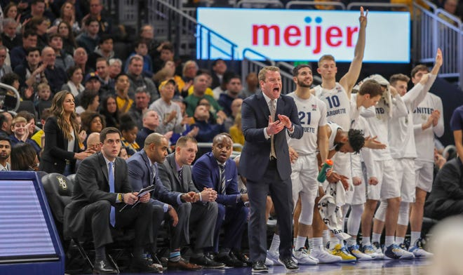 Jake Presutti (left) has been promoted to assistant coach for the Marquette men's basketball team.