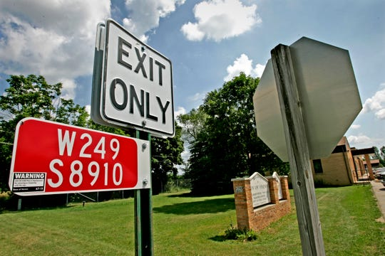 Signs direct traffic outside town hall in Vernon in this 2005 file photo. Recently, town residents filed a recall petition for one of their supervisors over alleged misconduct regarding a controversial boundary agreement.