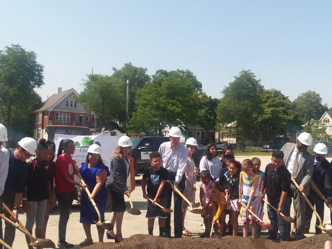 Mayor Tom Barrett leads the groundbreaking at Longfellow Public School for the development of their green space.