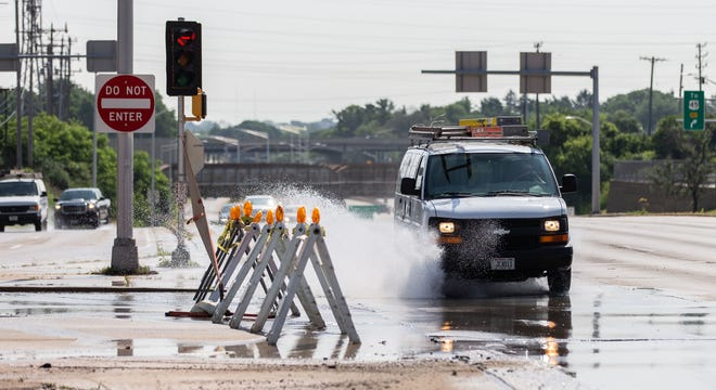 The northbound lanes of North 124th Street are blocked at West Capitol Drive due to a water main break on Tuesday morning, July 9.