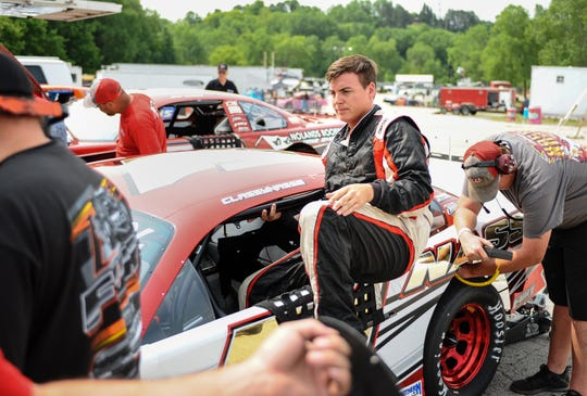 Steven Nasse gets out of his car after making a run during the Slinger Nationals practice day Monday at Slinger Speedway.