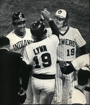 Robin Yount (right) and Manny Trillo welcome Fred Lynn at home plate after his grand slam in the 1983 all-star game. Rod Carew was also on base for the only grand slam in all-star game history.