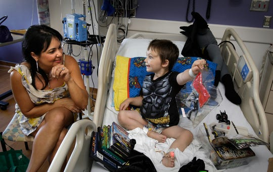 Amylynne Santiago Volker and her son, Nic, in a photo from 2010. With Nic as their patient, doctors and researchersatChildren's Hospital and the Medical College of Wisconsin became the first in the world to sequence all of a person's genes and use the information to pinpoint a new disease.