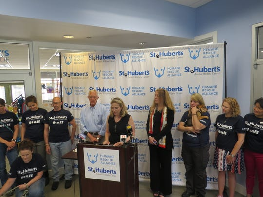 With former St. Hubert's CEO Heather Cammisa at her side,  Humane Rescue Alliance of Washington D.C.  President and CEO Lisa LaFontaine speaks during a press conference to announce St. Hubert's is merging with the Alliance to create first regional, community-based, multi-state animal welfare organization in the nation.  July 9, 2019