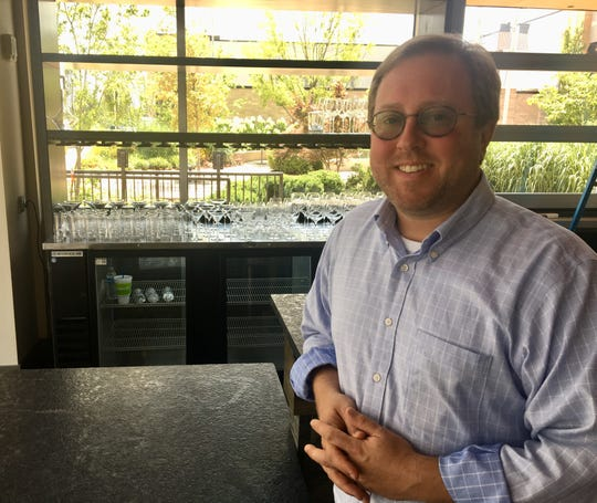 "Chef Mitchell Murphree stands in the bar of Steakhouse Five, which he calls ""a classic steakhouse."" Plans are to open July 17."