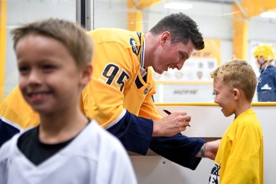 New Predators player Matt Duchene signs a jersey for one of the kids at a hockey camp Tuesday at Ford Ice Center in Antioch.