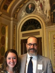 Mattie Ree Neal, 17, and her dad, renowned artist Michael Shane Neal, stand together in the U.S. Capitol Building underneath a portrait painted by the elder Neal of Sen. Arthur H. Vandenberg. It is one of five portraits by Neal on permanent display in the Capitol.