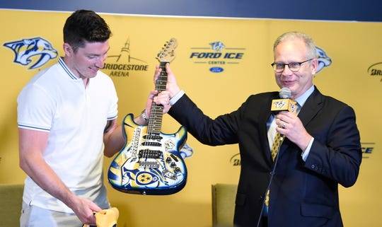 Nashville Mayor David Briley welcomes the newest Predator, Matt Duchene, by giving him a guitar Tuesday at Ford Ice Center in Antioch.