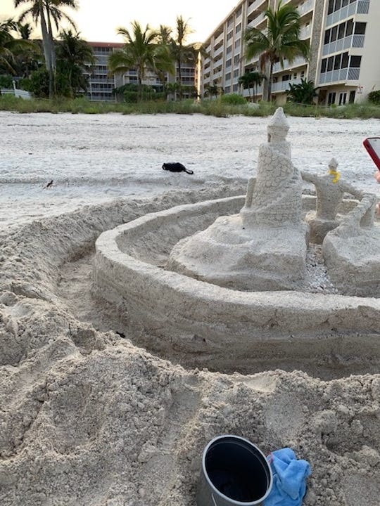 A sandcastle on Bonita Beach entrapped a sea turtle hatchlings on the morning of Thursday, July 4, 2019. Turtle Time, a volunteer group that monitors turtle nests, said it is important to fill in holes and level sandcastles when you leave the beach.