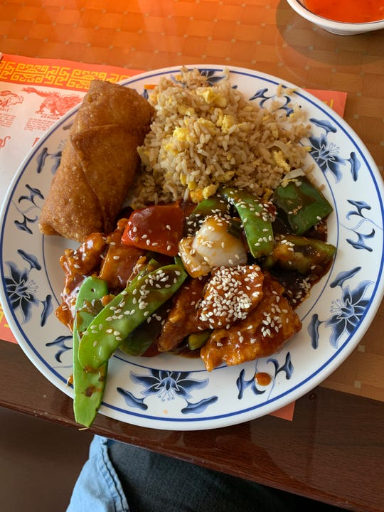 Sesame chicken, fried rice and an egg roll from Golden Leaf Restaurant.