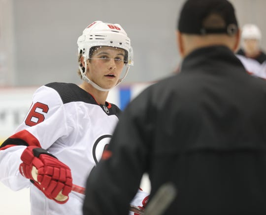 Jack Hughes talks with the coach of the Binghamton Devils, Mark Dennehy as Hughes works out with other young players in the DevilÕs organization at their 2019 Development Camp held at the Devils practice facility in Newark.