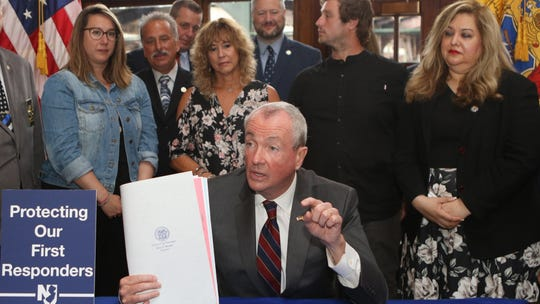 Governor Phil Murphy is shown in Jersey City, seconds after signing The Bill Ricci World Trade Center Rescue, Recovery, and Cleanup Operations Act and the Thomas P. Canzanella Twenty First Century First Responders Protection Act. Monday, July 8, 2019