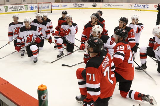 Thew young players take a knee and listen to the coaches instructions as they participate in the DevilÕs organization at their 2019 Development Camp held at the Devils practice facility in Newark.