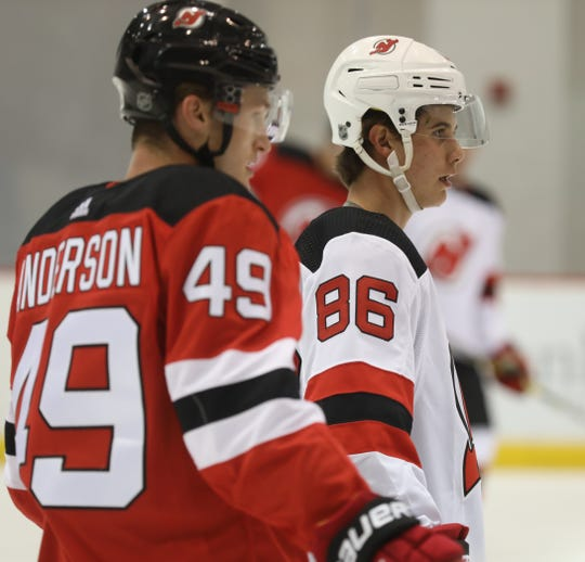 Joey Anderson waits for his turn to participate in a drill with Jack Hughes. Hughes worked out with other young players in the DevilÕs organization at their 2019 Development Camp held at the Devils practice facility in Newark.