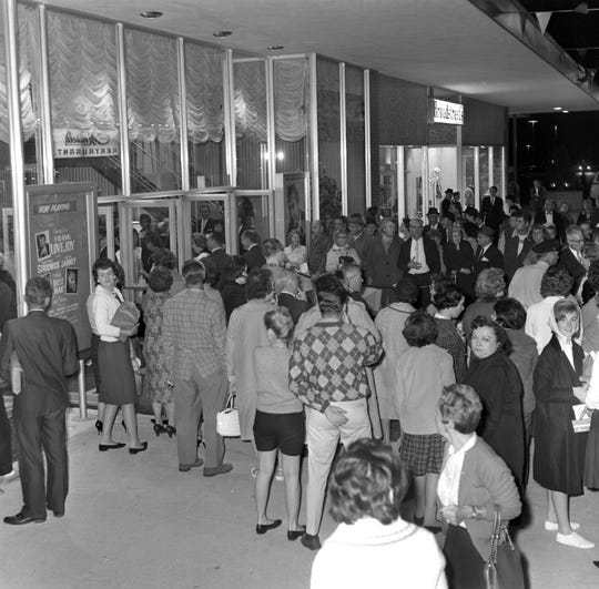 Opening night crowds attend the first performance at Playhouse on the Mall, a new theater inside the Bergen Mall, Paramus, NJ. September 18, 1962.