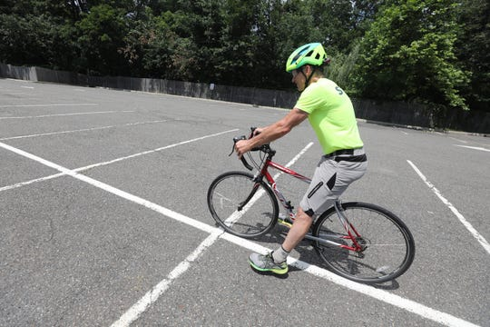 Here, bicycle riding instructor, Paul Mickiewicz  demonstrate how he teaches adults to ride a bike in a parking lot on a Saturday morning at Montclair State University. He offers bicycle riding lessons for adults who never learned how to ride a bike.
