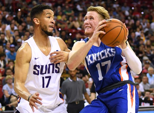 Jul 7, 2019; Las Vegas, NV, USA; New York Knicks forward Ignas Brazdeikis (17) drives against Phoenix Suns guard Billy Garrett Jr (17) during the second half of an NBA Summer League game at Thomas & Mack Center.
