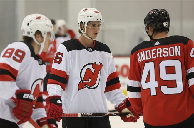 Danny Weight, Jack Hughes and Joey Anderson as they wait to take part in a drill. Hughes worked out with other young players in the DevilÕs organization at their 2019 Development Camp held at the Devils practice facility in Newark.