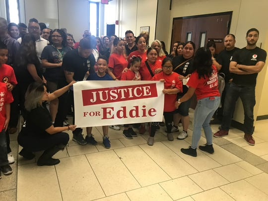 Supporters of Edilberto Torres, who stands accused of sexual assault of a minor, posed for a group photo in Superior Court in Newark after Torres was released pending his trial in August 2019.