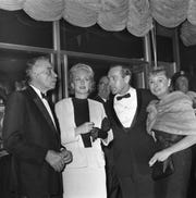 Opening night crowds attend the first performance at Playhouse on the Mall, a new theater inside the Bergen Mall, Paramus, NJ. Actor Walter Abel, actress Celeste Holm, theater producer Robert Ludlum with a guest. September 18, 1962.