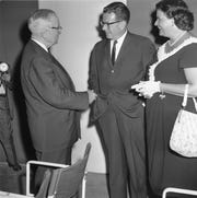 """Former President Harry S. Truman attends a stage performance of """"Time of the Cuckoo,"""" a play starring daughter Margaret, at the Playhouse on the Mall in Paramus, NJ. Truman chats in the theater lobby with NJ Democratic candidate for Governor, Richard J. Hughes. September 1, 1961"""