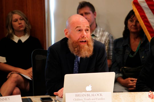 New Mexico Children, Youth and Families Secretary Brian Blalock talks about his agency's efforts to begin community-based mental health programs during a news conference in Santa Fe, New Mexico, on Tuesday, July 9, 2019.