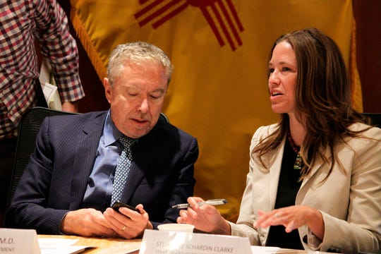 New Mexico Taxation and Revenue Secretary Stephanie Schardin Clarke, right, and Human Services Secretary David Scrase prepare for a news conference in Santa Fe, New Mexico, on Tuesday, July 9, 2019. Gov. Michelle Lujan Grisham gathered members of her cabinet to roll out a progress report on her administration's first six months in office.