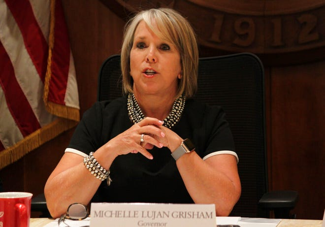 New Mexico Gov. Michelle Lujan Grisham provides a progress report on her first six months in office during a news conference in Santa Fe, New Mexico, on Tuesday, July 9, 2019.