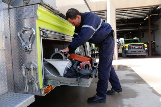 Engineer Ian Rutter examines equipment on a fire truck in March 2017 at the Bloomfield Fire Department.