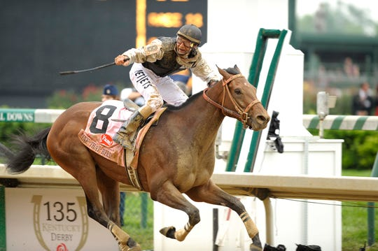 Calvin Borel and Mine That Bird cross the finish line in front and win Kentucky Derby 135.