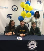 Stevenson's Carter Ackman (middle) has signed to play football at the University of Rochester.