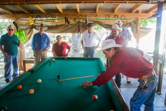 Armando Ruiz plays billiards at the home of Jesus Espinoza, who now hosts his friends for pool games in Thermal after complaining about racial discrimination at the Indio Senior Center.