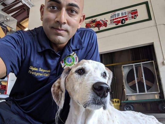 "Stephen Rampersad poses for a selfie with his beloved dog, Wilson, on Sunday, July 7, 2019 at the fire station where he works in Milton. Wilson passed away the next day, but not before having his ""best day ever"" thanks to the kindness of strangers."