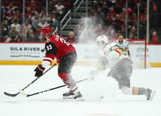 Coyotes defenseman Alex Goligoski (33) controls the puck as he sprays ice at Gila River Arena late last year.