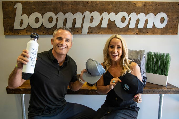 Zack and Emily Barna, owners of the branded marketing gear company Boompromo, pose for a photo at their headquarters in Tempe on June 20, 2019.