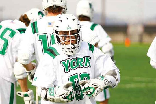 Cole Fenton scored a goal on a hidden-ball trick for the York College men's lacrosse team during the 2018 season.